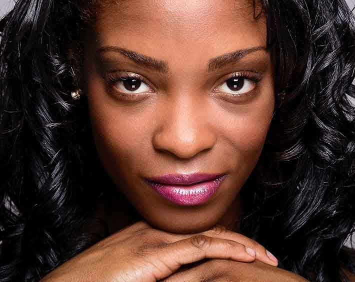 Portrait of an attractive black woman looking straight in the eyes