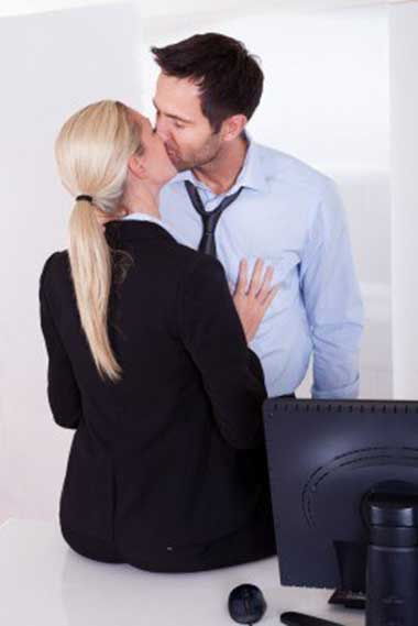 Man and woman being intimate in office