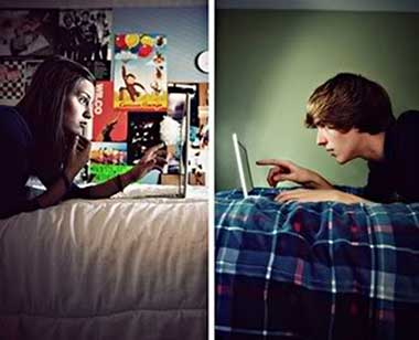 College couple in a long distance relationship chatting over the internet