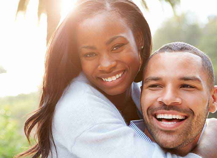Your boyfriend - African American woman holding her boyfriend from the back